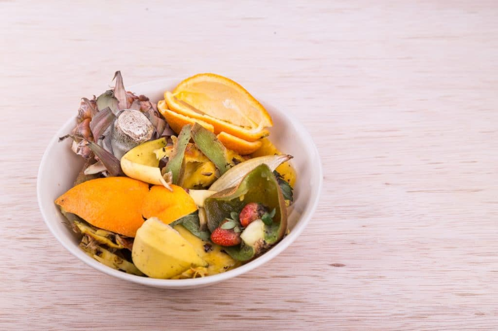 Flushing food scraps down the drain can cause bad smells